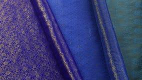 Härliga bakgrundshushållhemslöjder av thailändskt silke arkivbild