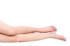 Härliga ben bantar kvinnor isolerad vit bakgrund Fotografering för Bildbyråer