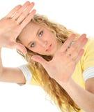 härliga blonda händer upp royaltyfri bild