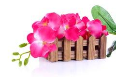 Härliga färger av plast- blommor Arkivbild