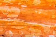 Härliga färger och texturer av en sandstenvägg arkivbild