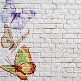Härliga fjärilar för grafitti på en tegelstenvägg Royaltyfri Fotografi
