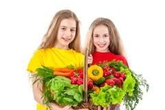 Härliga flickor med grönsaker Arkivfoton