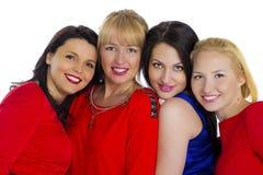 härliga fyra grupperar unga lyckliga isolerade sexiga vita kvinnor Isolerat på whi royaltyfri foto