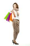 Härliga hållande shoppingpåsar för ung kvinna royaltyfria bilder