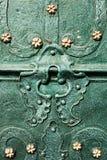 Härliga järnstycken på dörrarna Arkivfoto