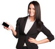 Härliga kvinnor i dräktvisning ilar telefonen Royaltyfria Bilder