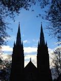 Härliga kyrkliga torn i solnedgångtid, Litauen arkivbilder