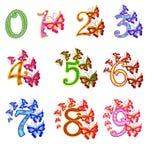 Härliga mång--färgade nummer med fjärilar Arkivfoton