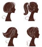 härliga silhouettesvektorkvinnor Arkivfoto