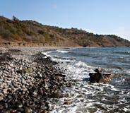 härliga stenar för hav för kustliggandepebbles Arkivfoton