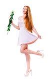 Härliga unga kvinnor med blomman av eustomaen fotografering för bildbyråer