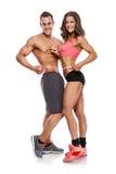 Härliga unga sportiga par med ett mäta band arkivfoton