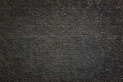 Härliga våta svartgrå färger kritiserar stentextur med vattendroppar royaltyfri bild