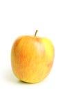 Härligt äpple som isoleras på vit bakgrund Arkivbild