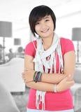Härligt asiatiskt le för flicka Royaltyfri Bild
