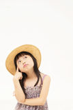 Tänkande härlig asiatisk liten flicka Royaltyfria Bilder