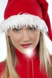 härligt barn för kvinna för hattholding s santa royaltyfria foton