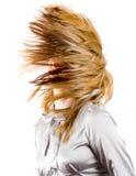 härligt blont bläddrande hår Arkivfoton
