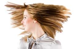 härligt blont bläddrande hår Arkivfoto