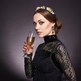 härligt champagnekvinnabarn Royaltyfri Foto