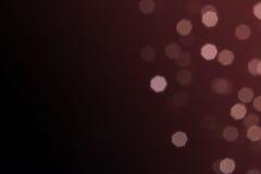 Härligt defocused LETT ljus filtrerat bokehabstrakt begrepp med marsala tonar eller röd vinrankasignalbakgrund Arkivfoto