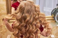 Härligt hår av lilla flickan Royaltyfria Foton