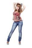 härligt jeanskvinnabarn Arkivfoto