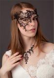 härligt maskeringskvinnabarn Royaltyfri Foto