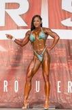 Härligt och Buff Pro Figure Competitor Royaltyfri Foto