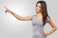 härligt pekande kvinnabarn royaltyfri fotografi