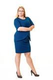 Härligt plus storleksanpassad kvinna i blåttklänning Royaltyfri Fotografi