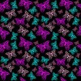 Härligt seamless med färgrika fjärilar Arkivfoto