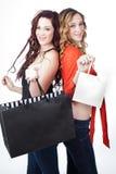 Härligt tvilling- shoppa för systrar arkivbild