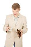 Härligt visar en ung man att han har i plånboken en en docka Fotografering för Bildbyråer