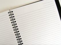 härskad öppen cirkel för anteckningsbok arkivfoto