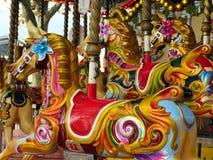 Hästar på en karusell Royaltyfri Foto