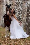 hästkvinnabarn Royaltyfri Fotografi