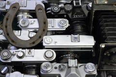 Hästsko på kameror arkivbild