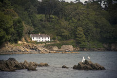 Häuschen auf der Küste stockbilder