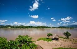 Häuschen entlang dem Mekong-Fluss Stockfotografie