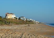 Häuser auf dem Strand Stockbild
