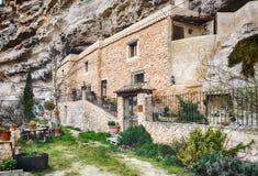 Häuser im Stein im Flussbett III Stockbild