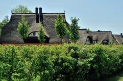 Häuser mit Strohdach Lizenzfreies Stockfoto