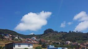 Häuser und Hügel Lizenzfreie Stockbilder