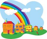 Häuser und Regenbogen Lizenzfreie Stockfotos