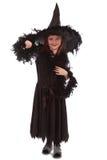 Häxa i svart klänning och hatt Arkivfoto