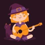 Häxaflicka som spelar gitarren bredvid hennes katt Royaltyfria Bilder