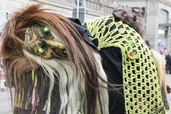 Häxamaskering med gröna skinande ögon Royaltyfri Bild