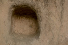 Hål i gyttjavägg Arkivfoto